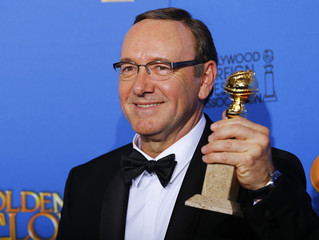 """Actor Kevin Spacey poses backstage with his award for Best Performance by an Actor in a Television Series for """"House of Cards"""" at the 72nd Golden Globe Awards in Beverly Hills"""