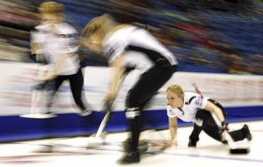Switzerland's third Schori delivers a stone during her draw against Canada at the World Women's Curling Championships in St.John