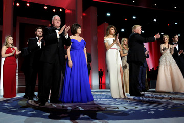 President Donald Trump with his wife Melania and Vice President Mike Pence with his wife Karen greet the audience