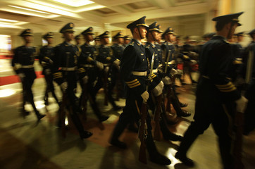 An honour guard from the Air Force practise their march ahead of a welcome ceremony for Cambodia's PM Hun Sen at the Great Hall of the People in Beijing