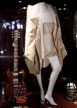 An avant-garde coat designed by Thomas Hanisch and worn by singer Lady Gaga on her 28th birthday in 2014 is seen along with a Gibson SG Les Paul guitar that belonged to Eric Clapton on display at the Hard Rock Cafe in the Manhattan borough of New York City
