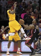 Miami Heat's Cole strips the ball from Cleveland Cavaliers Irving in the last seconds of the fourth quarter of their NBA basketball game