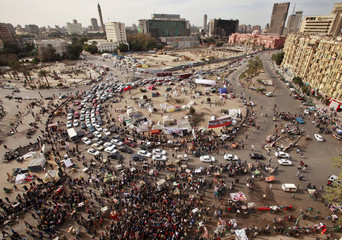 Demonstrators gather at Tahrir square during a protest demanding the army hand power to civilians in Cairo