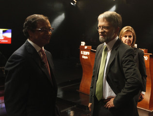 Presidential candidate Mockus of the Green Party speaks with presidential candidate Petro of the Polo Democratico before a presidential debate in Bogota