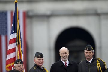 Tom Wolf poses for a photograph with the honor guard after his inauguration as the 47th Governor of Pennsylvania at the State Capitol in Harrisburg