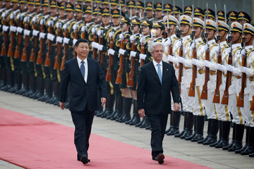 China's President Xi Jinping and Uruguay's President Vazquez review honour guards during a welcoming ceremony at the Great Hall of the People in Beijing