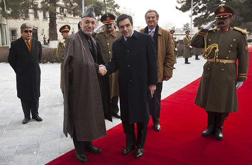 Afghan President Hamid Karzai shakes hands with the French Prime Minister Francois Fillon in Kabul