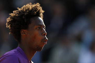 Monfils of France reacts during his quarter-final match against Federer of Switzerland at the French Open tennis tournament at the Roland Garros stadium in Paris