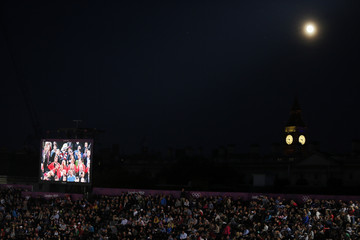 Spectators watch a preliminary round beach volleyball match at the London 2012 Olympic Games at Horse Guards Parade