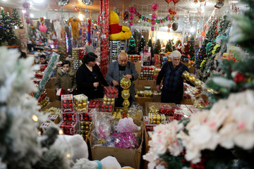 Iraqi people shop for Christmas decorations at a market in the northern Iraqi city of Erbil