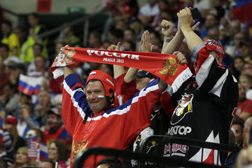 Fans of Russia cheer during their Ice Hockey World Championship semifinal game against the U.S. at the O2 arena in Prague