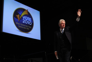 Former U.S. President Bill Clinton takes the stage at a rally in San Jose
