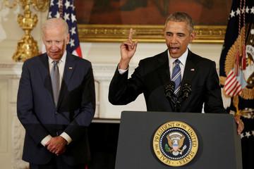President Barack Obama (R) delivers  remarks at a tribute to Vice President Joe Biden (L)