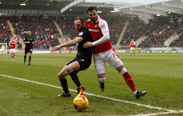 Aidy White of Barnsley (L) and Anthony Forde of Rotherham United in action