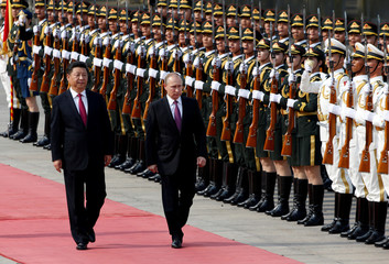 Russian President Vladimir Putin and his Chinese counterpart Xi Jinping attend a welcoming ceremony outside the Great Hall of the People in Beijing