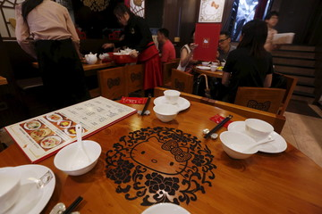 A Hello Kitty image is carved on a table in a Hello Kitty-themed Chinese restaurant in Hong Kong