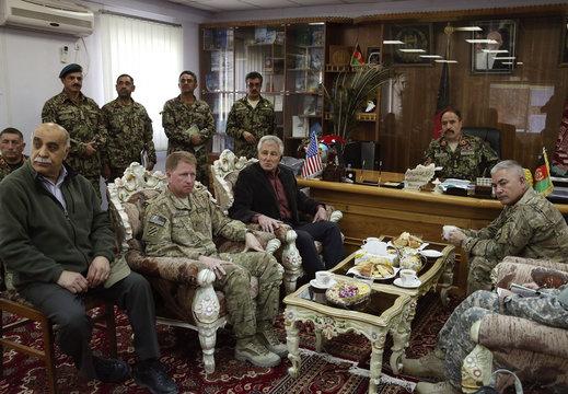 U.S. Defense Secretary Hagel listens to Afghan National Army Maj. Gen. Waziri as they look at a map at Forward Operating Base Gamberi