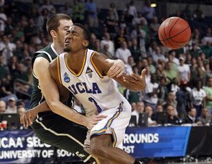Spartans' Sherman fouls Bruins' Lee late in the second half during their second round NCAA basketball game in Tampa