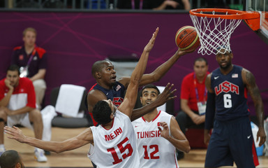 Durant of the U.S. goes for a lay-up past Tunisia's Mejri and Romdhane as James of the U.S. watches