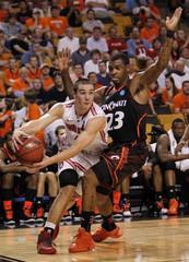 Ohio State Buckeyes' Craft drives around Cincinnati Bearcats' Kilpatrick during the first half of their men's NCAA East Regional basketball game in Boston