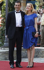 Actor Sander and his wife Carolina Godet arrive for opening of Bayreuth Wagner opera festival in Bayreuth