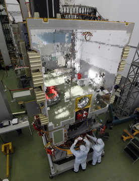 "Fitters of space apparatus work on Ukrainian ""Lybid"" geostationary telecommunications satellite inside assembly workshop of Reshetnev Information Satellite Systems company in Zheleznogorsk"