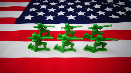 Toy soldiers on the American Flag