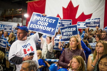 Supporters cheer before Canada's PM and Conservative leader Harper's capmaign rally in London