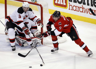 Ottawa Senators' Michalek tries to keep the puck from New Jersey Devils' White during the second period of their NHL hockey game in Ottawa