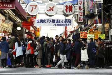 People crowd Ameyoko market as they shop for food and goods for the upcoming New Year holidays in Tokyo