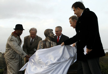 Officials take part in a ceremony to unveil a statue of Ronald Reagan, the 40th U.S. president, in Tbilisi