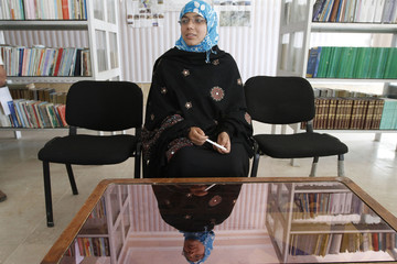 Serena Faizi, 25, one of the provincial candidate elections from Kandahar, sits at a public library in Kandahar province