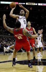 San Antonio Spurs Tony Parker shoots over New Jersey Nets Deron Williams during the second half of their NBA basketball game in San Antonio