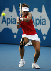 Li hits a return against Pennetta during the Sydney International tennis tournament