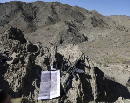 A map and a rifle are seen at a U.S. soldier's position near the town of Walli Was in Paktika province