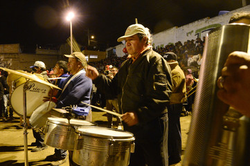 Participants play music during the El Novillo de Bombas festival in Mira, north of Quito
