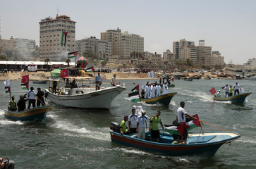 Hamas naval police ride boats during an exercise in preparation for the arrival of the Freedom Flotilla at the Gaza