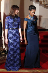 U.S. first lady Michelle Obama and Samantha Cameron, wife of British Prime Minister David Cameron, walk at the White House in Washington