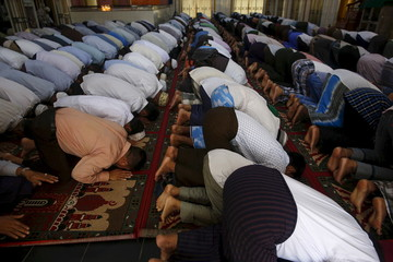 Muslims perform the Eid al-Adha prayer at a mosque in Yangon, Myanmar