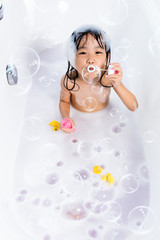 Asian little Chinese girl blowing bubbles