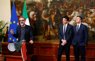 "Osteria Francescana's chef-owner Massimo Bottura talks in front of Italy Prime Minister Matteo Renzi and Italy Agriculture Minister Maurizio Martina during a ceremony, to celebrate his victory in the ""World's 50 Best Restaurants 2016"", at Chigi Palace in"