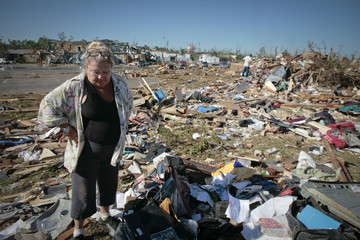 Modell Harkins looks at her belongings in the aftermath of deadly tornados in Tuscaloosa