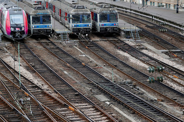 Trains of French state-owned railway company SNCF and railway tracks are seen at the Gare Saint Lazare railway station in Paris