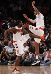 Syracuse's Waiters and Southerland celebrate during the second half of their game against Uconn at the 2012 Big East men's NCAA college basketball tournament at Madison Square Garden in New York
