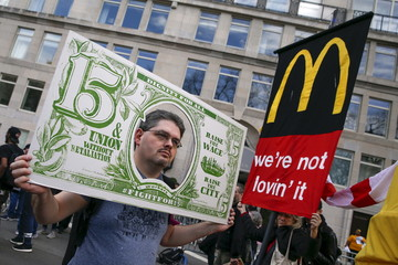 Demonstrators rally during demonstrations asking for higher wages in the Manhattan borough of New York