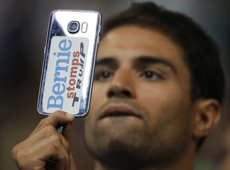 A man films with his mobile phone during roll call at the Democratic National Convention in Philadelphia