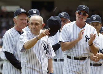 Hall of Famer Yogi Berra tips his cap during introductions for the 65th Old Timers' Day game in New York