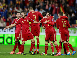Spain's Isco celebrates with teammates after scoring against Belarus during their Euro 2016 Group C qualifying soccer match in Huelva