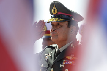 Thailand's Prime Minister Prayuth Chan-ocha gestures as he arrives before a military parade marking his retirement as commander in chief of the Royal Thai Army at The Chulachomklao Royal Military Academy in Nakorn Nayok