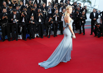 "Actress Naomi Watts poses on the red carpet as she arrives for the screening of the film ""How to Train Your Dragon 2"" out of competition at the 67th Cannes Film Festival in Cannes"
